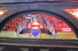 Stained glass window over a player piano in the Musée Méchanique at Pier 39